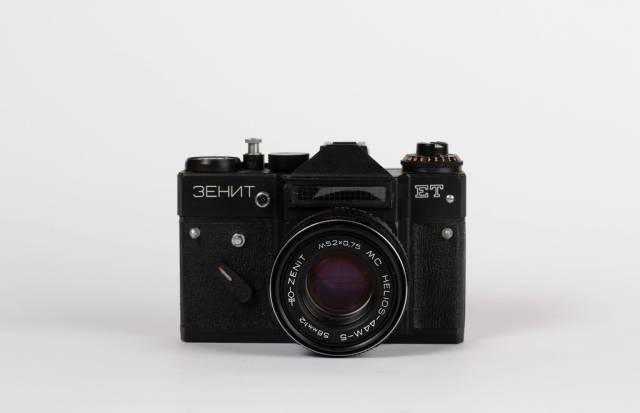 Black vintage film camera on white background