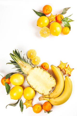 Fresh tropical fruits on white background