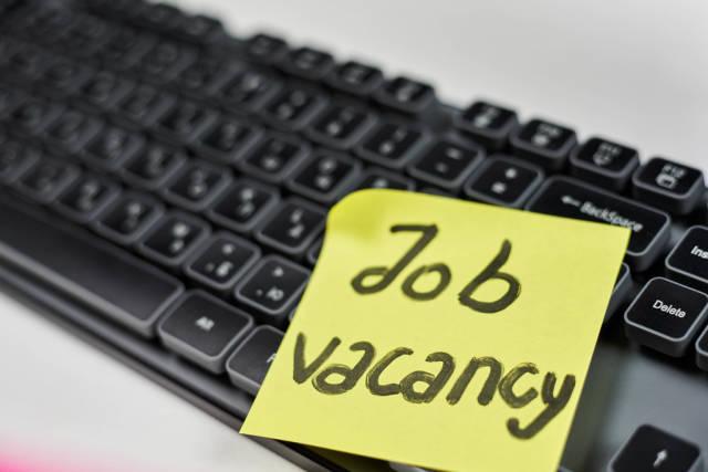 Job recruitment advertisement. Job vacancy - phrase written on the sticky note. HR, Recruitment concepts