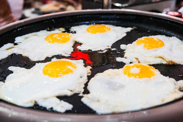 Close up of fresh eggs being fried