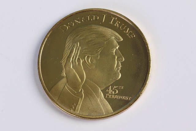 Donald Trump on a golden coin