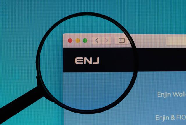 Enjin Coin logo under magnifying glass