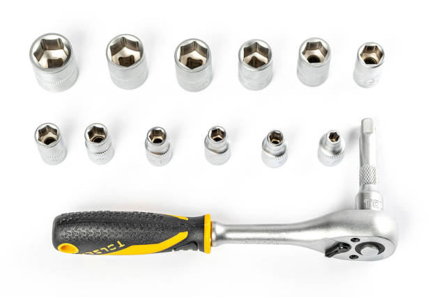 Set of ratchet sockets on white background with ratchet wrench