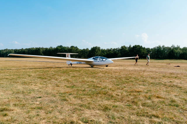 Female student pushing glider by hand to the start position