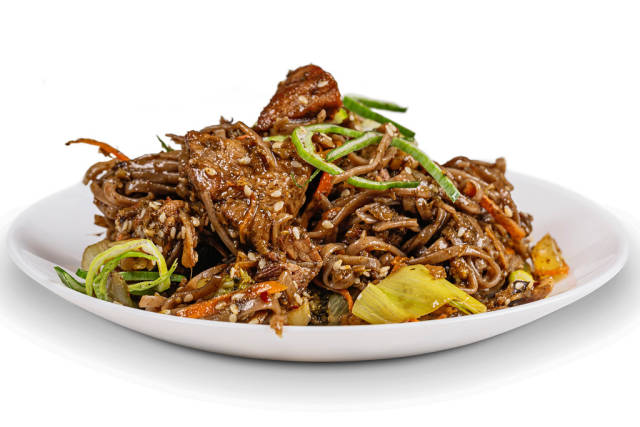 Soba noodles with pork in a spicy sauce