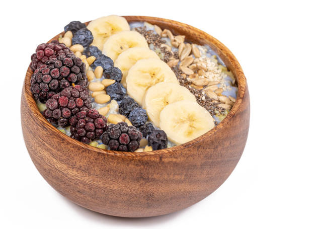 Diet and healthy food, cereal with seeds, pine nuts, blackberries, banana and blackthorn