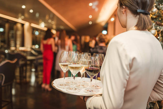 Wine Plate Holding By Waitress In Restaurant