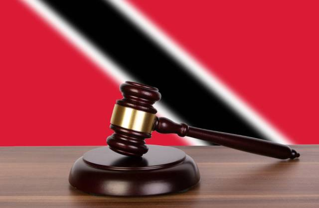 Wooden gavel and flag of Trinidad and Tobago