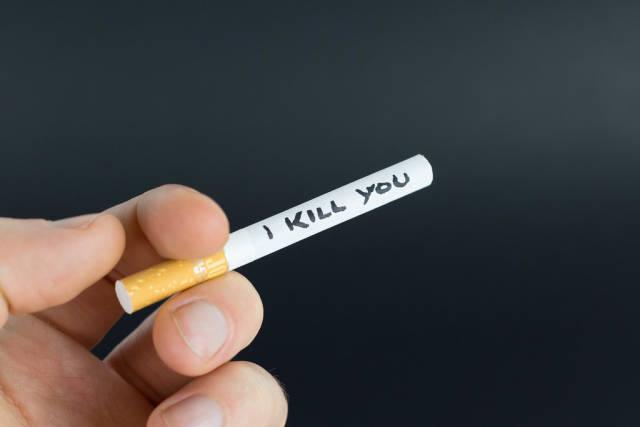 Man holding a cigarette