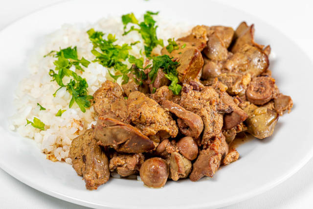 Close up of braised chicken liver with hearts and boiled rice
