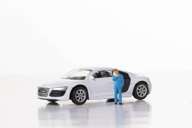 Man with sports car on white background