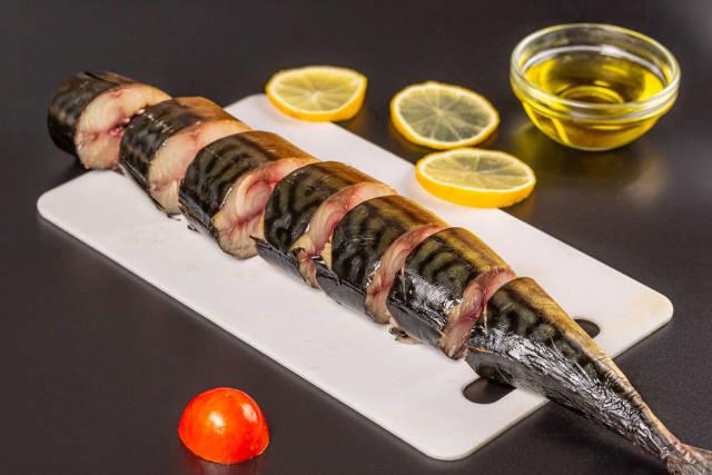 Sliced smoked mackerel on a cutting board