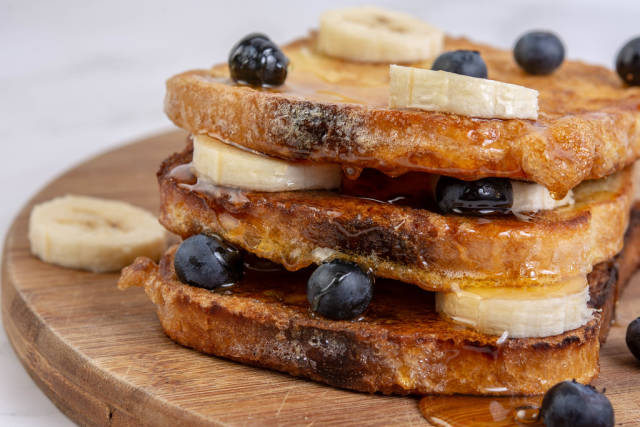 French Toast with Banana and Blueberries and Honey