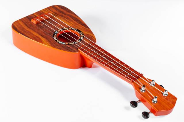 Small guitar (ukulele) on white background.