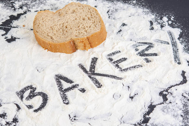 Word Bakery on the spilled flour on the black table