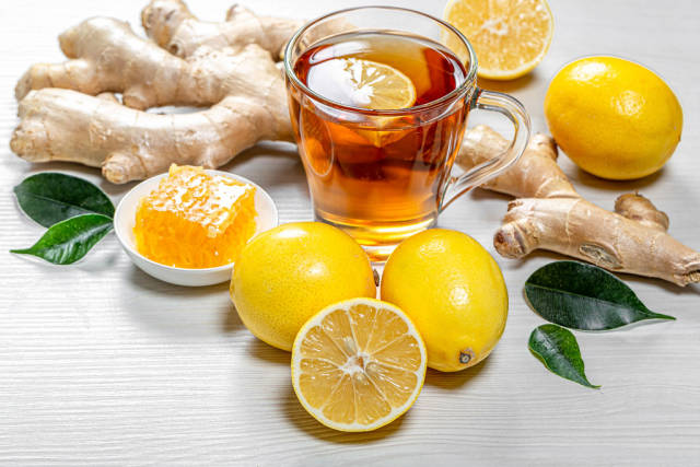 Healthy natural green tea with ginger root, honey and lemons
