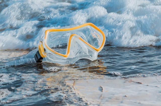 Tauchermaske am Strand