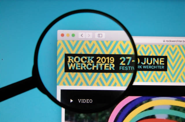 Rock Werchter logo on a computer screen with a magnifying glass