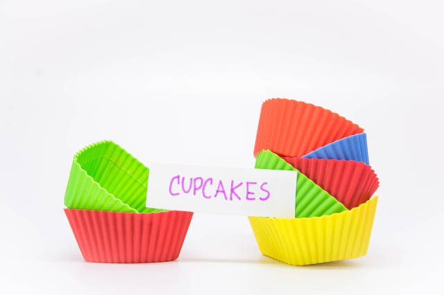 Cupcake liners with a note reading CUPCAKES