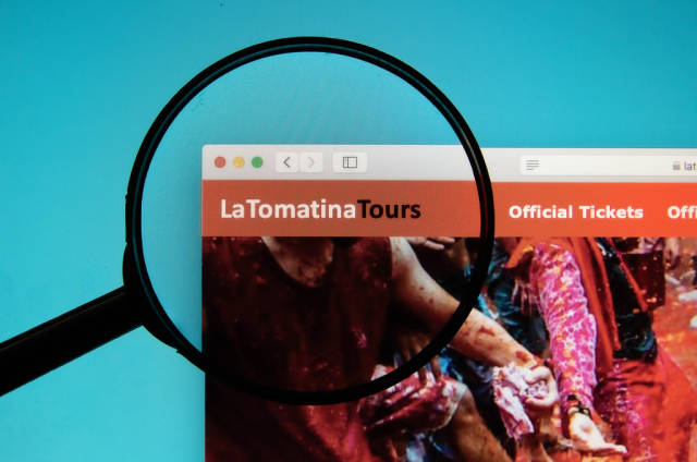 La Tomatina logo on a computer screen with a magnifying glass