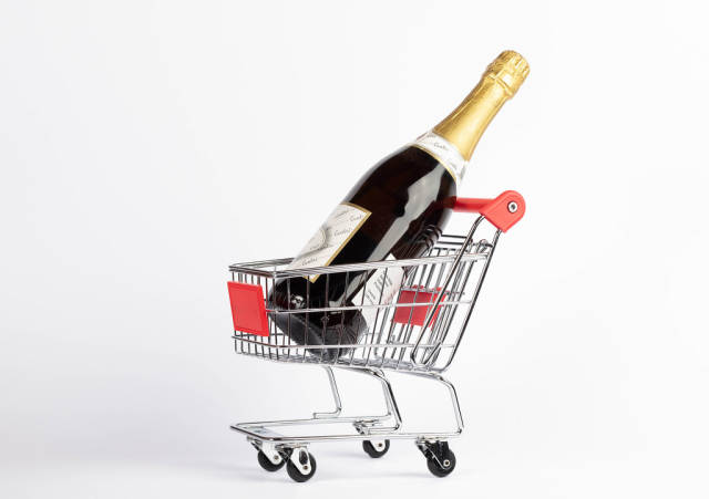 Champagne bottle in shopping cart