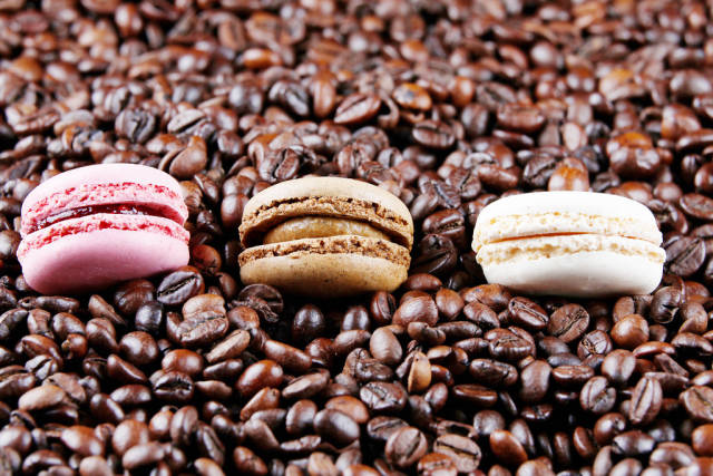 Macaron cakes in coffee beans background