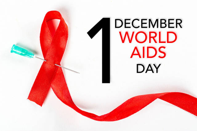 Fight against sexually transmitted diseases. Aids awareness sign red ribbon. World Aids Day concept.