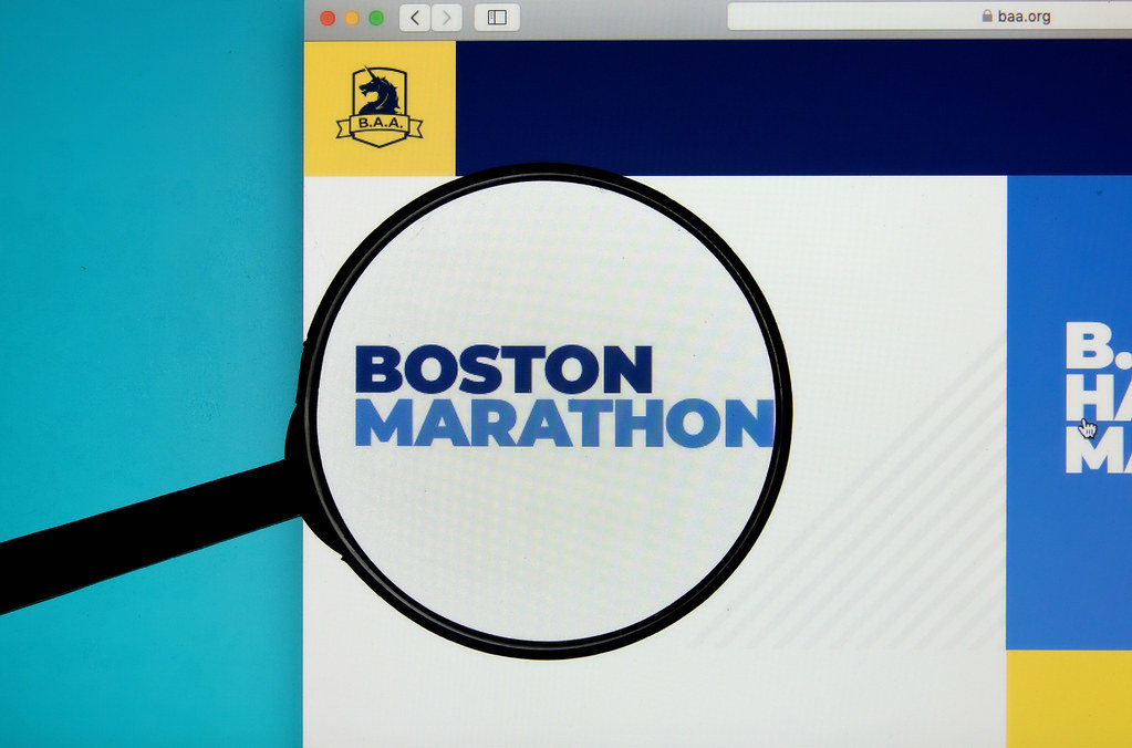 Boston Marathon logo on a computer screen with a magnifying glass