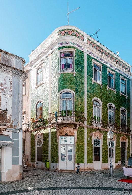 Green tile building on the corner in Lagos city center