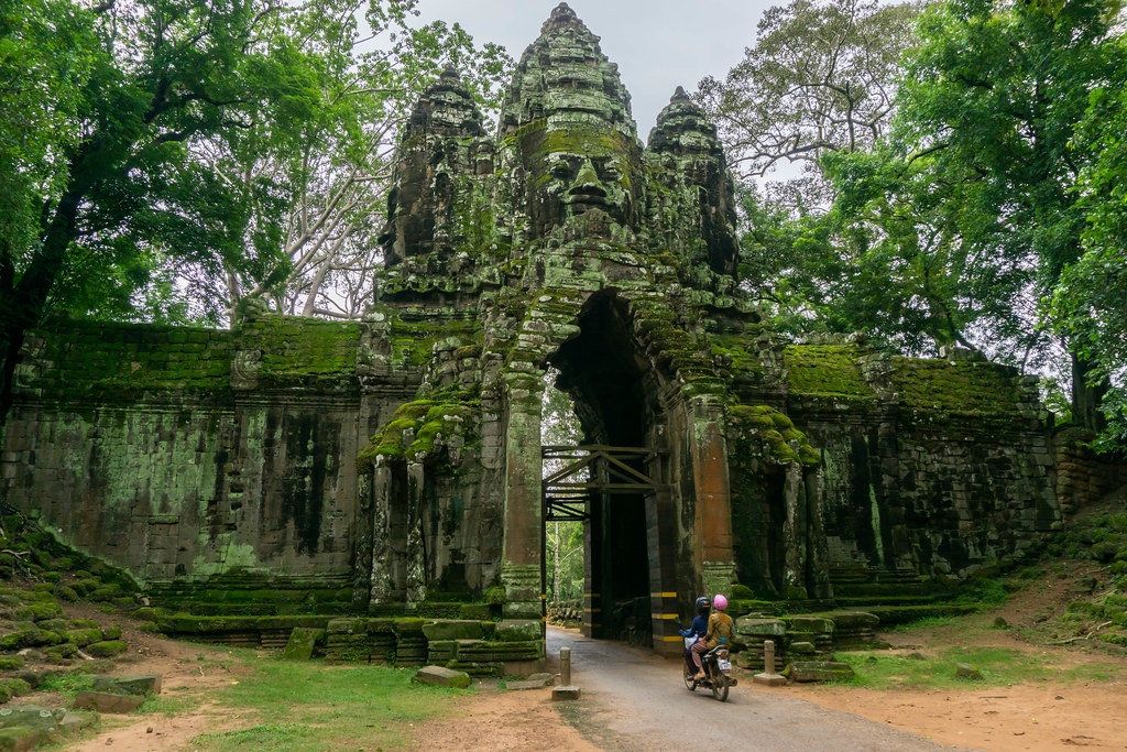 Motorbike driving through Victory Gate in Angkor Thom Area in Siem Reap