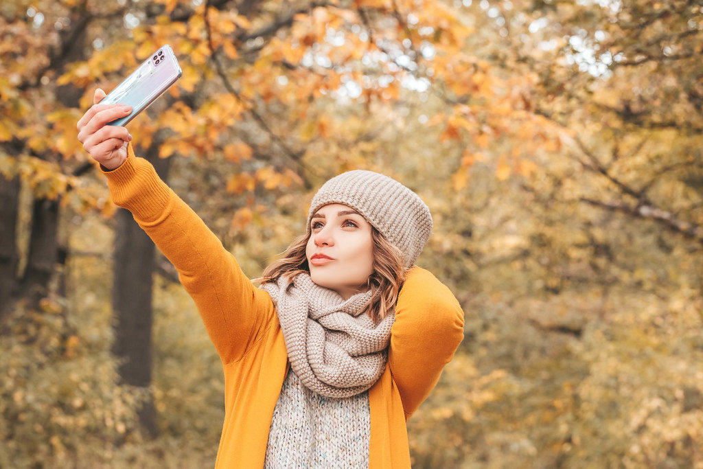 Autumn selfie, girl with smartphone
