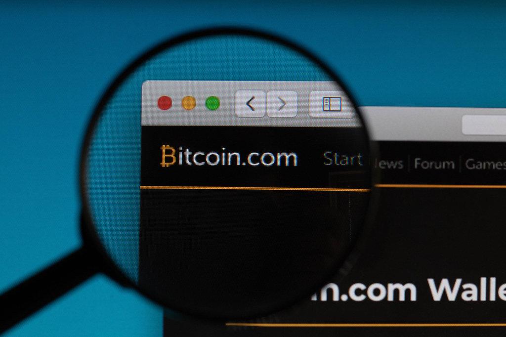 Bitcoin.com logo under magnifying glass