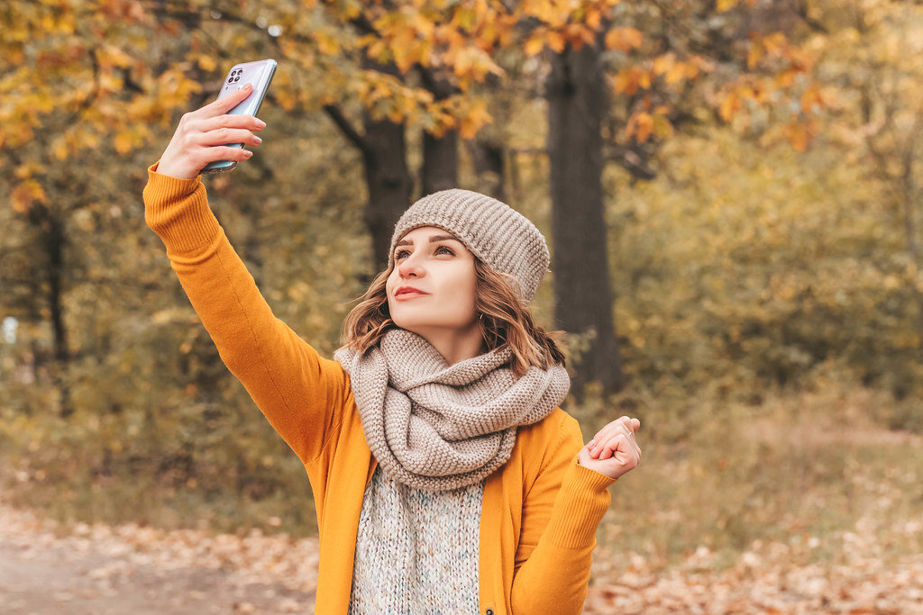 Girl takes a selfie on her mobile phone