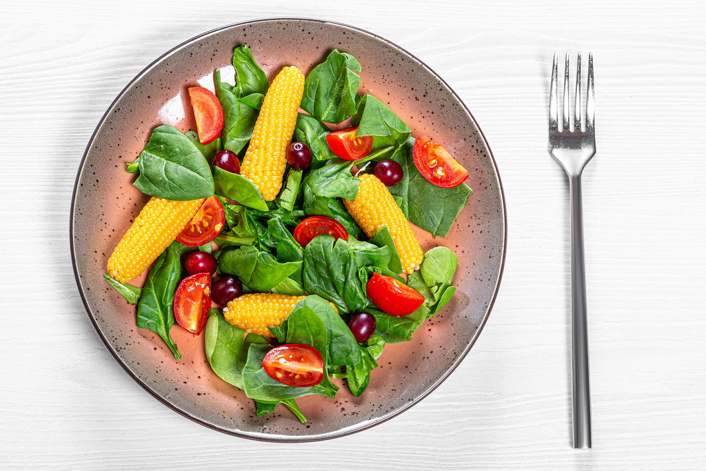 Top view vegetable salad with dogwood berries