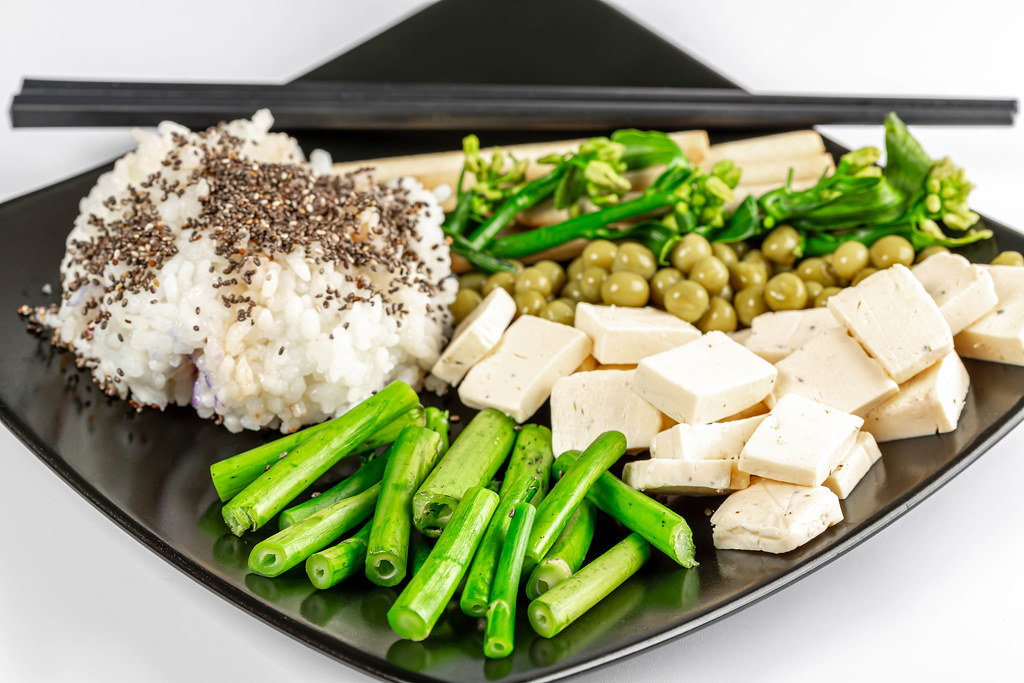 Vegetarian lunch - rice, peas, broccolini with cheese and chia seeds