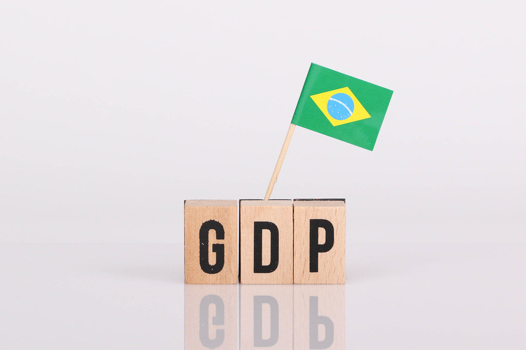 Wooden blocks with the word GDP and flag of Brasil