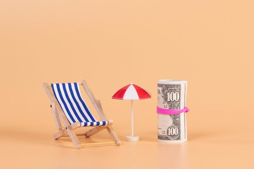 A deck chair, umbrella and money roll