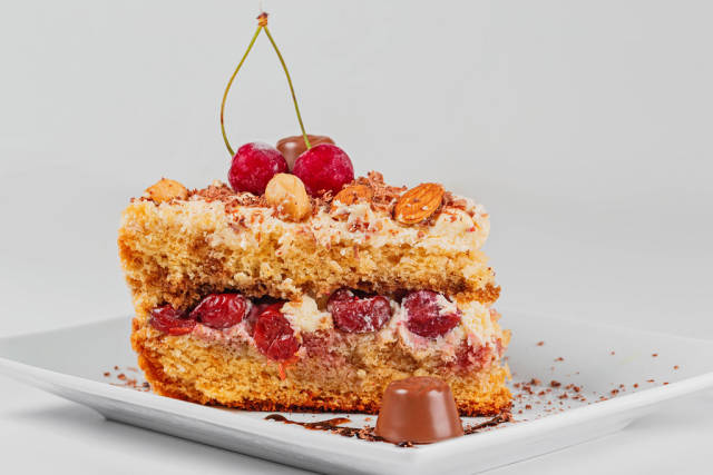 A piece of delicious cherry cake with nuts