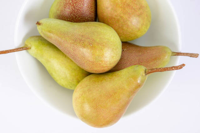 Delicious Sweet Pears in the bowl above white background