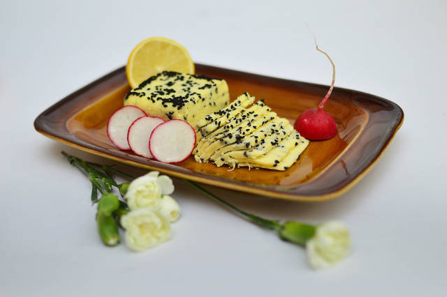 Home cheese with blackcurrant seeds