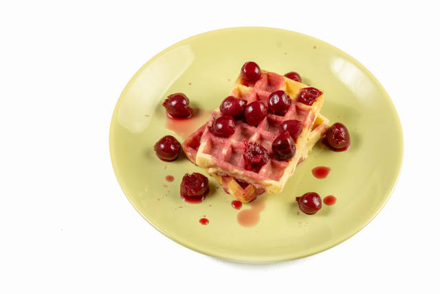 Cherry Compote served with Waffles on the plate