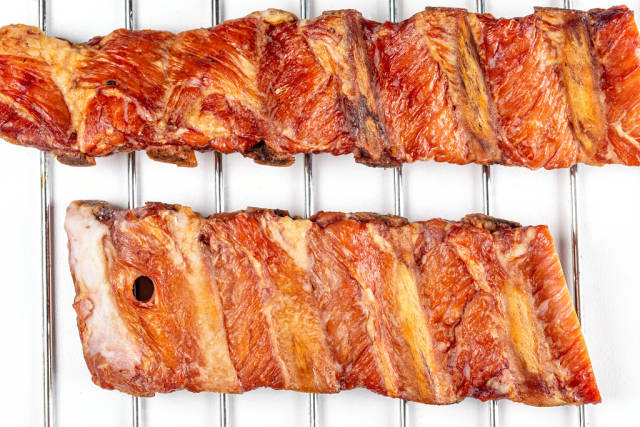 Top view, smoked ribs on a metal grille