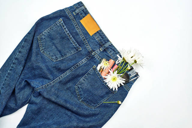 Female jeans pants and make-up tools