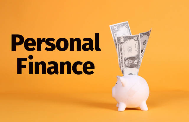 Piggy bank with dollar banknotes and Personal Finance text