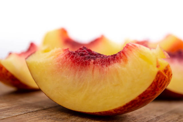 Closeup of Sliced Peach on the board