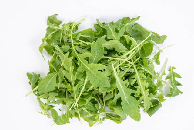 Fresh Healthy Green Rucola above white background