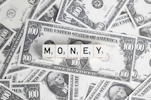 Pile of cash with text Money