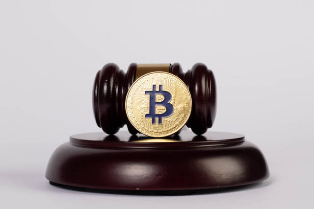 Law gavel and golden Bitcoin