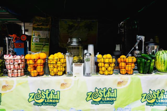 Various fruits on display on a lemon stand