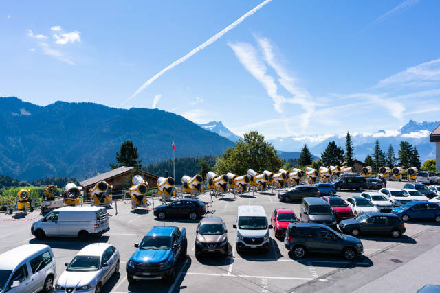 Parking lot in Swiss mountains full of snowguns during low season